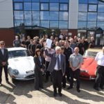Classic Motor Cars chairman Peter Neumark handing over the company to the employees. Left to right: David Barzilay, Nick Goldthorp, Peter Neumark (with the papers), Tim Leese, Richard Coe, Richard Charlesworth and all the staff at CMC
